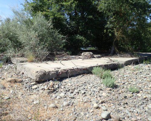 Tuolumne River Conservancy California - Buck Flat - Debris left from building haul road and bridge of New Don Pedro Dam